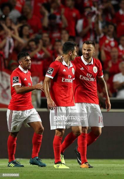 Benfica's forward Haris Seferovic from Switzerland celebrates scoring Benfica third goal with Benfica's forward Jonas from Brasil and Benfica's...