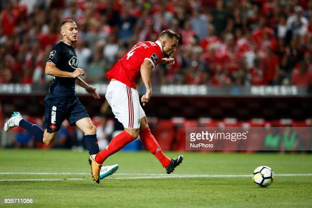 Benfica's forward Haris Seferovic shoots the ball to score his side's third goal during Premier League 2017/18 match between SL Benfica vs CF...