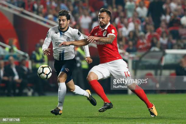 Benfica's forward Haris Seferovic vies for the ball with Feirense's defender Antonio Briseno during Primeira Liga 2017/18 match between SL Benfica vs...