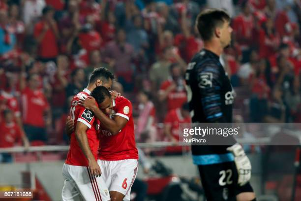 Benfica's forward Jonas celebrates his goal with Benfica's midfielder Filipe Augusto during Primeira Liga 2017/18 match between SL Benfica vs CD...