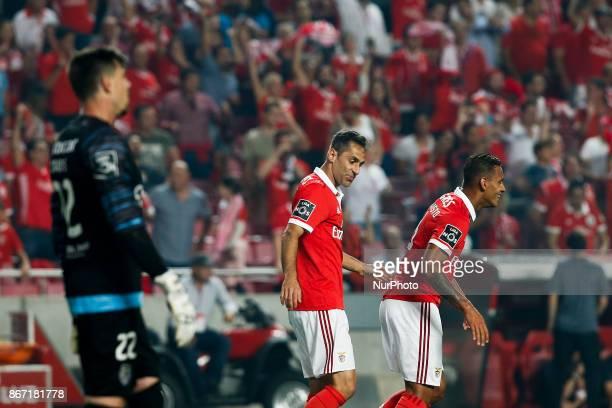 Benfica's forward Jonas celebrates his goal with Benfica's midfielder Filipe Augusto and Benfica's defender Andre Almeida during Primeira Liga...