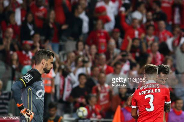 Benfica's forward Jonas celebrates with Benfica's defender Alejandro Grimaldo after scoring during the Portuguese League football match between SL...