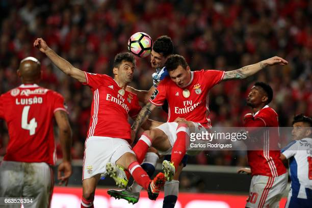 Benfica's forward Jonas from Brasil and Benfica's defender Victor NilssonLindelof vies with FC Porto's defender Ivan Marcano from Spain during the...