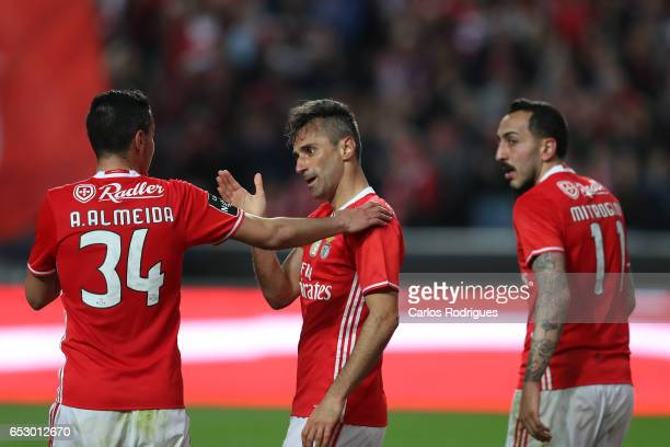 Benfica's forward Jonas from Brasil celebrates scoring Benfica fourth goal with his team mates Andre Almeida and Kostas Mitroglou during the match...