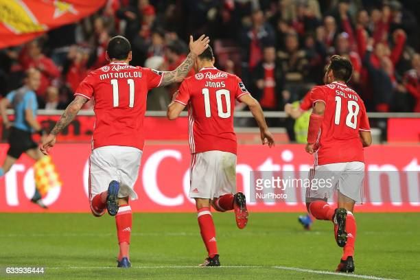 Benficas forward Jonas from Brazil celebrating after scoring a goal with Benficas forward Kostas Mitroglou from Greece and Benficas forward Toto...
