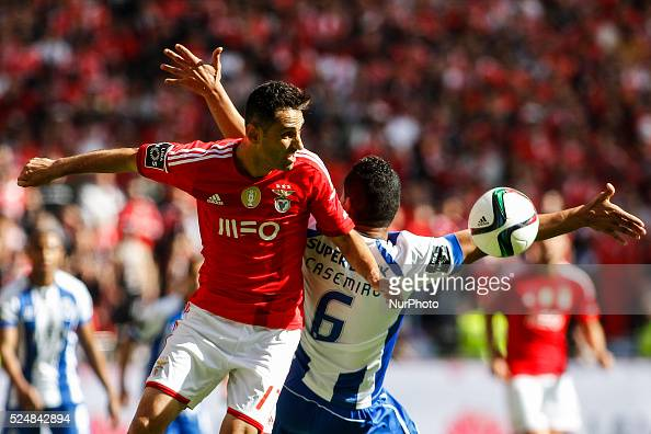 Benfica's forward Jonas vies with Porto's midfielder Casemiro during the Portuguese League football match between SL Benfica and FC Porto at Luz...