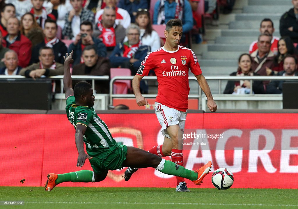 SL Benfica's forward Jonas with Rio Ave FC's midfielder Alhassan Wakaso in action during the Primeira Liga match between SL Benfica and Rio Ave FC at Estadio da Luz on December 20, 2015 in Lisbon, Portugal.