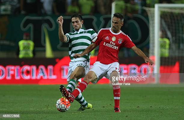 Benfica's forward Jonas with Sporting CP's defender Paulo Oliveira in action during the Portuguese Super Cup match between SL Benfica and Sporting CP...