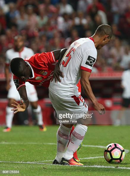 Benfica's forward Jose Gomes tackled by SC Braga's Brazilian defender Baiano in action during the Primeira Liga match between SL Benfica and SC Braga...
