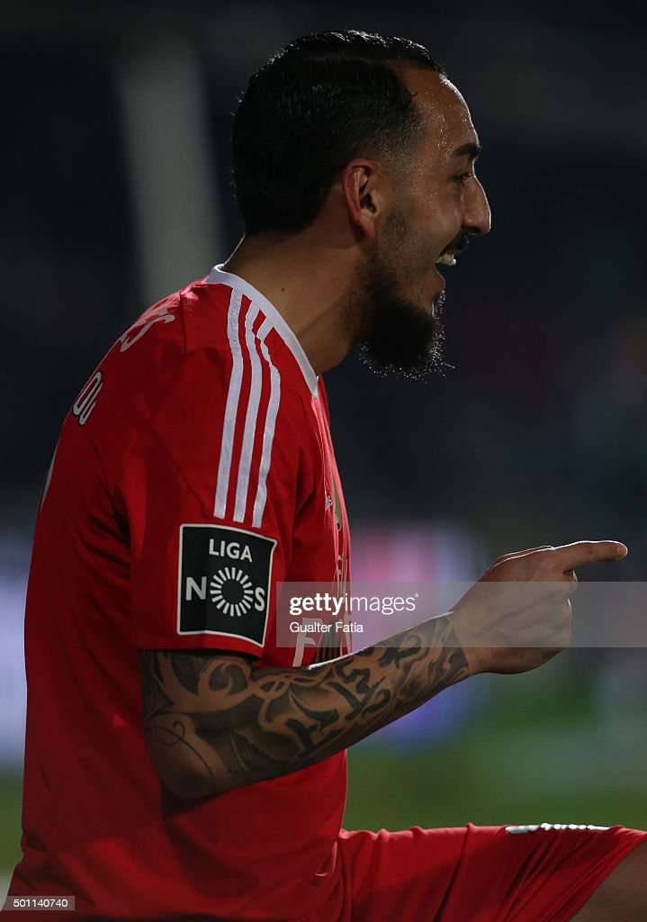 SL Benfica's forward <a gi-track='captionPersonalityLinkClicked' href=/galleries/search?phrase=Kostas+Mitroglou&family=editorial&specificpeople=2203870 ng-click='$event.stopPropagation()'>Kostas Mitroglou</a> celebrates after scoring a goal during the Primeira Liga match between Vitoria Setubal and SL Benfica at Estadio do Bonfim on December 12, 2015 in Setubal, Portugal.
