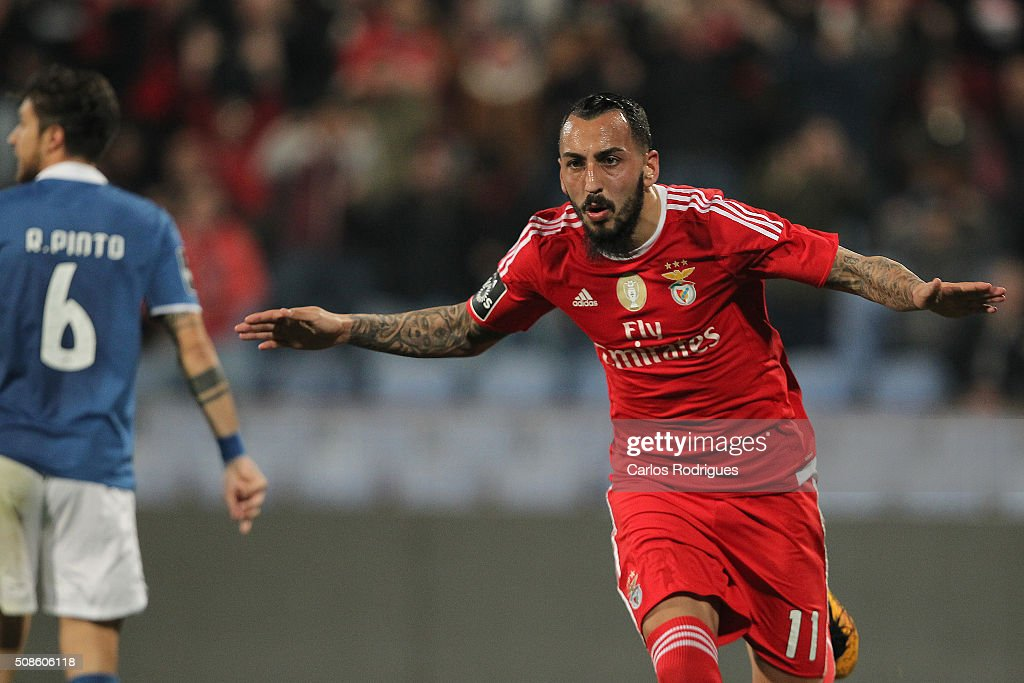 Benfica's forward <a gi-track='captionPersonalityLinkClicked' href=/galleries/search?phrase=Kostas+Mitroglou&family=editorial&specificpeople=2203870 ng-click='$event.stopPropagation()'>Kostas Mitroglou</a> celebrates scoring Benfica's goal during the match between Os Belenenses and SL Benfica at Estadio do Restelo on February 05, 2016 in Lisbon, Portugal.