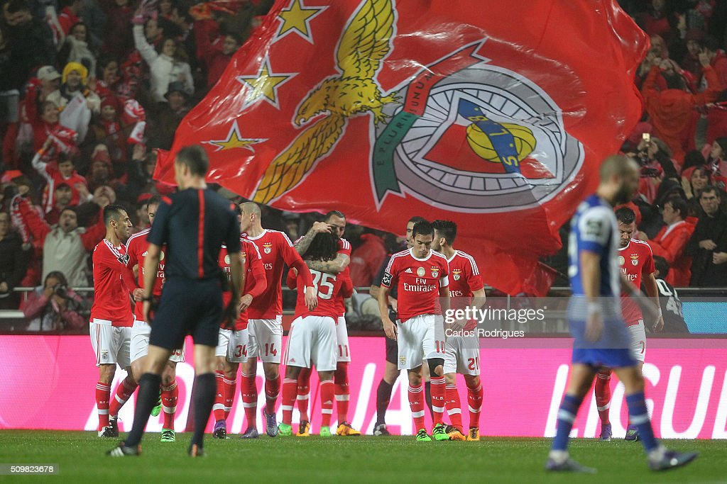 Benfica's forward <a gi-track='captionPersonalityLinkClicked' href=/galleries/search?phrase=Kostas+Mitroglou&family=editorial&specificpeople=2203870 ng-click='$event.stopPropagation()'>Kostas Mitroglou</a> celebrates scoring Benfica's goal with his team mates during the match between SL Benfica and FC Porto for the portuguese Primeira Liga at Estadio da Luz on February 12, 2016 in Lisbon, Portugal.
