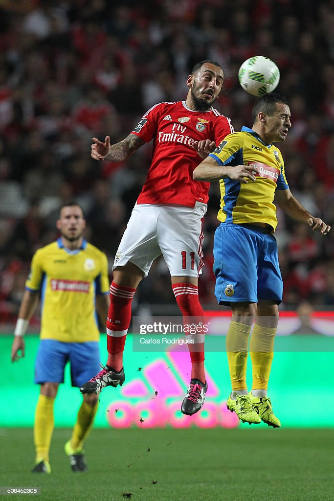 Benfica's forward Kostas Mitroglou higher that Arouca«s midfielder Artur heads the ball during the match between SL Benfica and FC Arouca at Estadio da Luz on January 23, 2016 in Lisbon, Portugal.