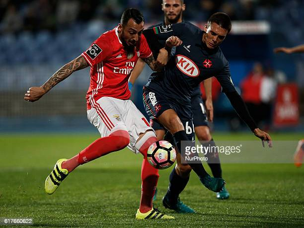 Benfica's forward Kostas Mitroglou vies for the ball with Belenenses's midfielder Joao Palhinha during Premier League 2016/17 match between CF...