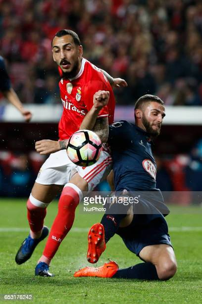 Benfica's forward Kostas Mitroglou vies for the ball with Belenenses's defender Domingos Duarte during Premier League 2016/17 match between SL...