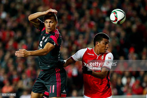 Benfica's forward Lima heads for the ball with Braga's defender Aderlan Santos during the Portuguese Cup football match between SL Benfica and SC...