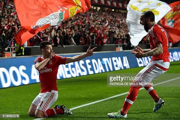 Benfica's forward Luis Fernandes 'Pizzi' celebrates with Benfica's Greek forward Kostas Mitroglou after scoring against SC Braga during the...