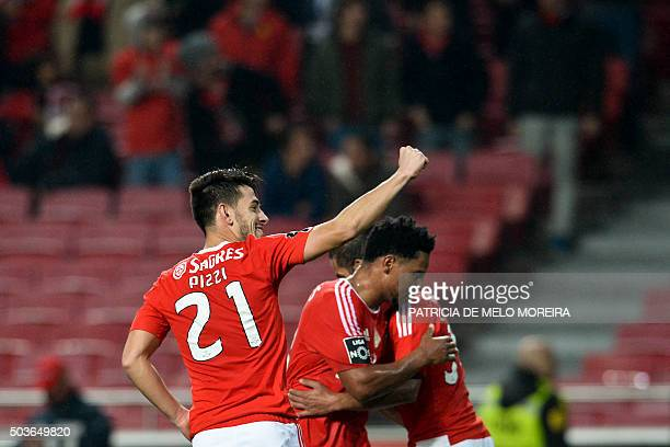 Benfica's forward Luis Fernandes 'Pizzi' celebrates with his teammates after scoring during the Portuguese league football match Benfica vs CS...