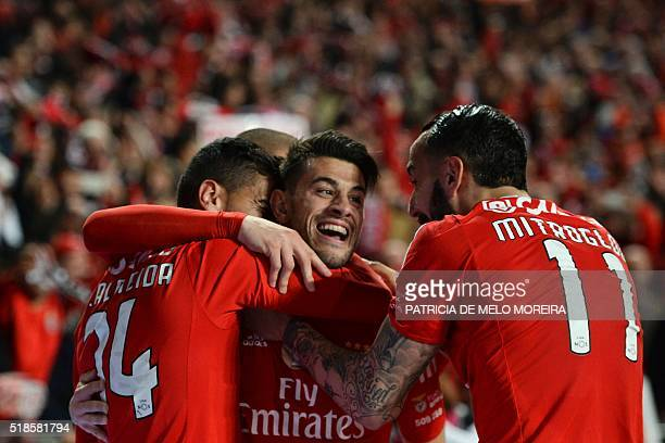 Benfica's forward Luis Fernandes 'Pizzi' celebrates with his teammates after scoring against SC Braga during the Portuguese Liga football match...