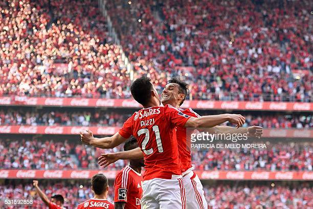 Benfica's forward Luis Fernandes 'Pizzi' jumps with Benfica's Brazilian forward Jonas Oliveira to celebrate a goal during the Portuguese league...