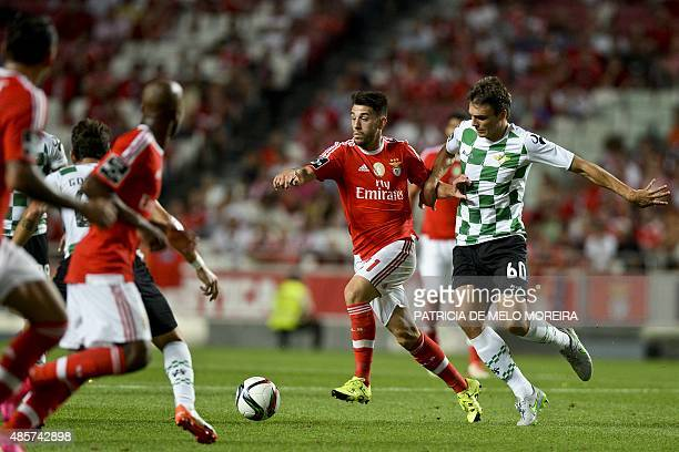 Benfica's forward Luis Fernandes 'Pizzi' vies with Moreirense's midfielder Joao Palhinha during the Portuguese league football match SL Benfica vs...