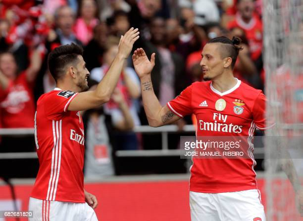 Benfica's forward Pizzi celebrates his goal with Serbian midfielder Ljubomir Fejsa during the Portuguese league football match SL Benfica vs Vitoria...