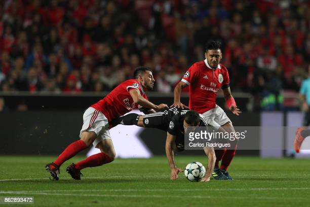 Benfica's forward Pizzi from Portugal tackles Manchester United midfielder Henrikh Mkhitaryan from Armenia during SL Benfica v Manchester United UEFA...