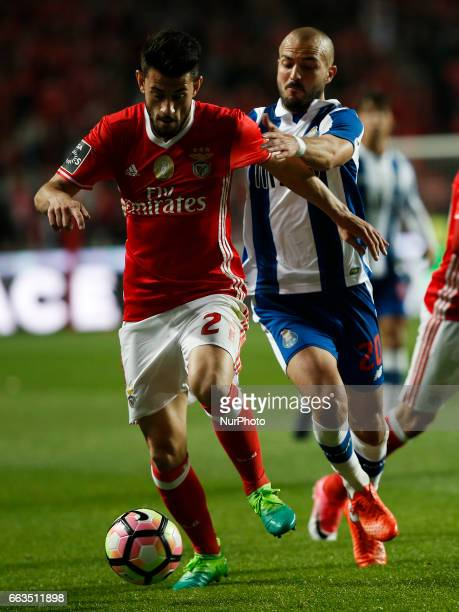 Benfica's forward Pizzi vies for the ball with Porto's midfielder Andre Andre during Premier League 2016/17 match between SL Benfica vs FC Porto in...