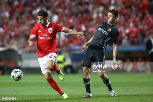 Benfica's forward Pizzi vies with CSKA's midfielder Aleksandr Golovin during the Champions League football match between SL Benfica and CSKA Moskva...