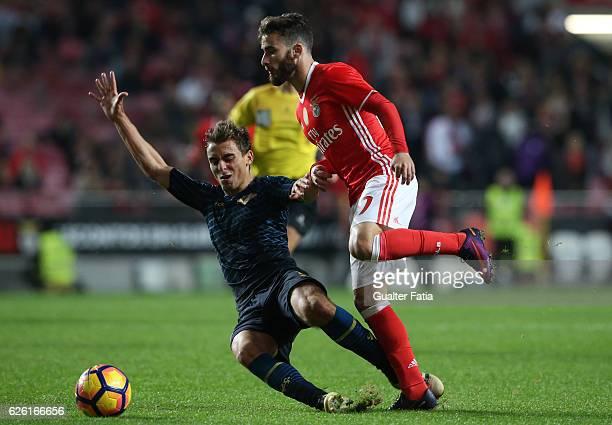 Benfica's forward Rafa Silva tackled by Moreirense«s midfielder Francisco Geraldes during the Primeira Liga match between SL Benfica and Moreirense...