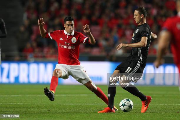 Benfica's forward Raul Jimenez from Mexico vies with Manchester United midfielder Nemanja Matic from Serbia for the ball possession during SL Benfica...