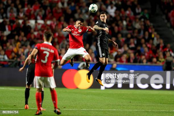 Benfica's forward Raul Jimenez from Mexico vies with Manchester United defender Victor Lindelof from Sweden for the ball possession during SL Benfica...