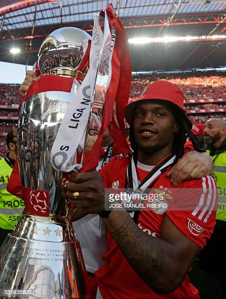 Benfica's forward Renato Sanches holds the trophy to celebrate Benfica's 35th Portuguese league title at the end of the Portuguese league football...