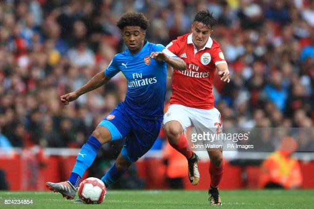 Benfica's Franco Cervi and Arsenal's Reiss Nelson battle for the ball during the Emirates Cup match at the Emirates Stadium London