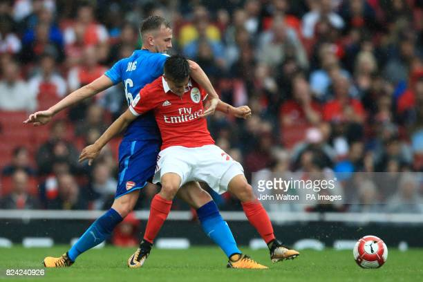 Benfica's Franco Cervi and Arsenal's Rob Holding battle for the ball during the Emirates Cup match at the Emirates Stadium London