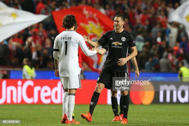 Benficas goalkeeper Mile Svilar from Belgium and Manchester Uniteds midfielder Nemanja Matic from Serbia during the match between SL Benfica v...
