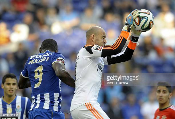 Benfica's goalkeeper Paulo Lopes catches the ball next to Porto's Colombian forward Jackson Martinez during the Portuguese League football match FC...