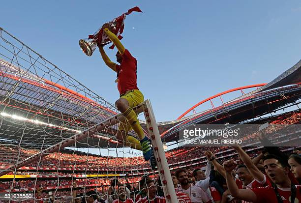 TOPSHOT Benfica's goalkeeper Paulo Lopes rises the trophy to celebrate Benfica's 35th Portuguese league title at the end of the Portuguese league...
