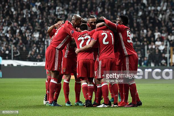 Benfica's Gocalo Guedes celebrates with teammates after scoring a goal during the UEFA Champions League Group B football match between Besiktas...