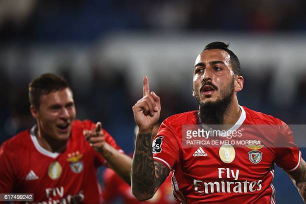 Benfica's Greek forward Konstantinos Mitroglou celebrates a goal during the Portuguese league football match between OS Belenenses and SL Benfica at...