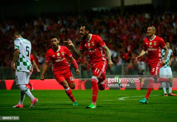 Benfica's Greek forward Konstantinos Mitroglou celebrates after scoring a goal during the Portuguese league football match Moreirense FC vs SL...
