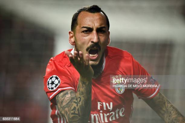 Benfica's Greek forward Konstantinos Mitroglou celebrates after scoring during the UEFA Champions League round of 16 first leg football match SL...