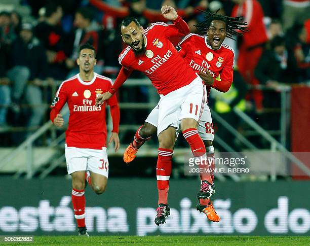 Benfica's Greek forward Konstantinos Mitroglou celebrates his goal with teammates forward Renato Sanches and defender Andre Almeida during the...