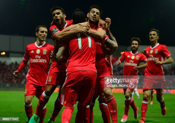 Benfica's Greek forward Konstantinos Mitroglou celebrates with teammates after scoring a goal during the Portuguese league football match Moreirense...