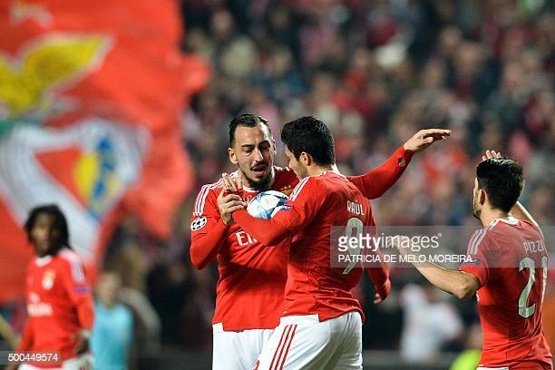 Benfica's Greek forward Konstantinos Mitroglou celebrates with his teammate Benfica's Mexican forward Raul Jimenez after scoring against Atletico de...