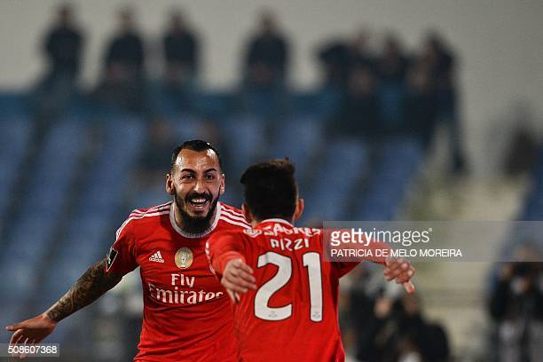 Benfica's Greek forward Konstantinos Mitroglou celebrates with his teammate Benfica's forward Luis Fernandes 'Pizzi' after scoring during the...