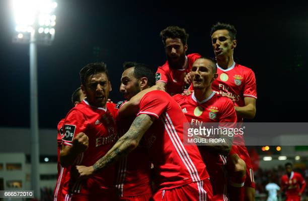 Benfica's Greek forward Konstantinos Mitroglou is congratulated by teammtes after scoring a goal during the Portuguese league football match...