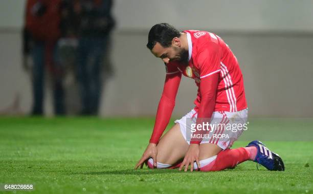 Benfica's Greek forward Konstantinos Mitroglou kneels on the pitch after missing a chance to score a goal during the Portuguese league football match...
