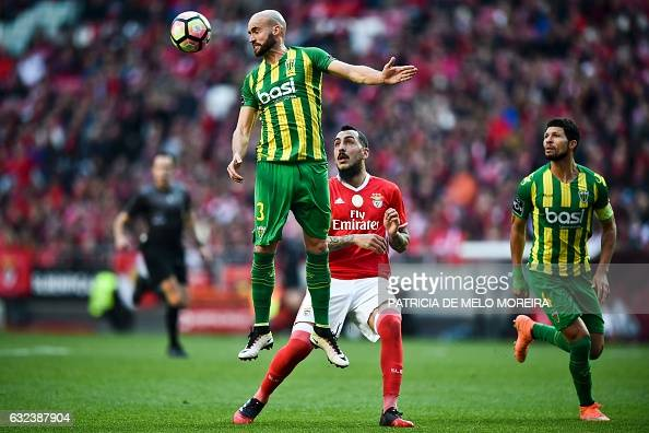 TOPSHOT Benfica's Greek forward Konstantinos Mitroglou vies with Tondela's defender Joao Pica during the Portuguese league football match SL Benfica...