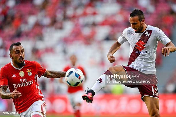Benfica's Greek forward Konstantinos Mitroglou vies with Torino's Serbian defender Nikola Maksimovic during the Eusebio Cup football match SL Benfica...